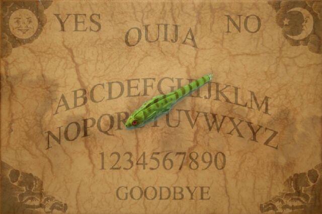 File:Ouija Board With Lizard Pen Pointer by mmpratt99.jpg