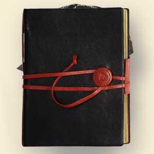 File:JOURNAL-BLACK-WITH-RED-TIES.jpg