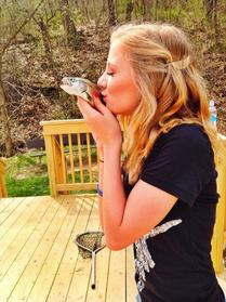 PH kissing a fish