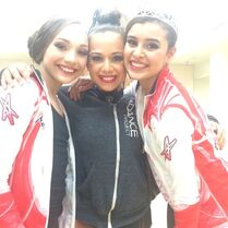 Talia Seitel posing with Maddie Ziegler and Kalani Hilliker