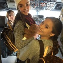 Kendall and Mackenzie in plane cockpit - posted 2015-01-21
