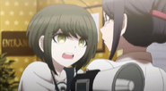 Komaru trying to warn a waitress