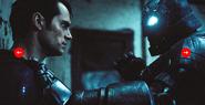 Armored Batman touches Superman