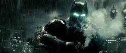 Batman uses a gas grenade