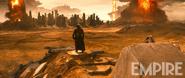Batman stands above a giant omega symbol