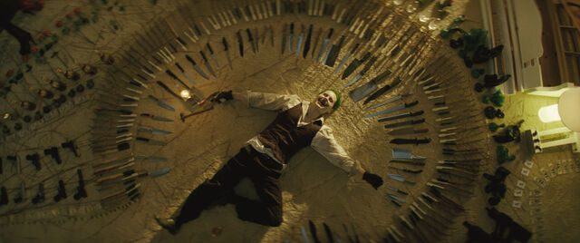 File:Joker surrounded by a circle of weapons.jpg