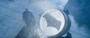 Batman stands by the Batsignal - promotional still
