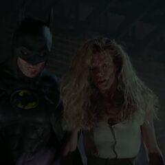 Batman and Vicki in the church.