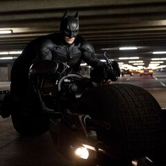 Batman riding the Batpod.
