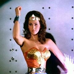 Wonder Woman deflecting bullets.