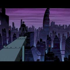 Batman surveys Gotham after the defeat of the Joker.