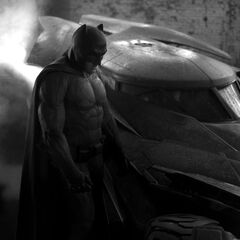 First look at Batman next to the Batmobile.