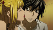 Misa-gives-L-a-peck