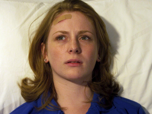 File:Holly J In Her Degrassi Uniform Lying In A Hospital Bed With A Bandage On Her Head Looking Confused.jpg