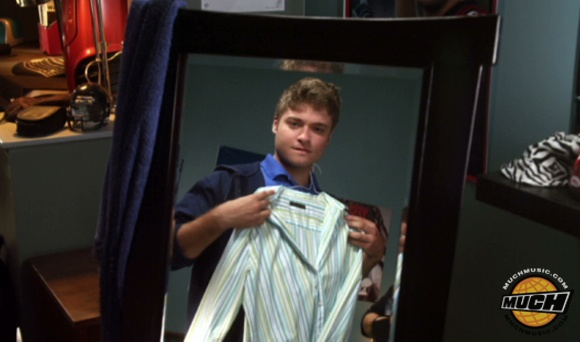 File:Riley Trying On A Shirt In His Room.jpg