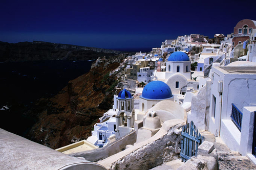 File:White-washed-houses-and-blue-domes-on-cliff-top-are-just-so-typically-greek.jpg