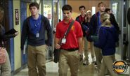 Drew Walking Down The Halls Of Degrassi In His Degrassi Uniform