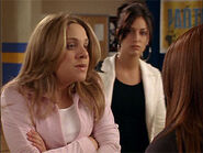 Paige telling something to Hazel without knowing Alex is behind her