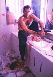 Die Hard- McClane injured in restroom