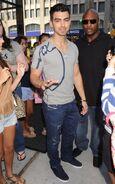 Joe-Jonas-Armani-Exchange-Cursive-T-shirt-Diesel-Jeans-1