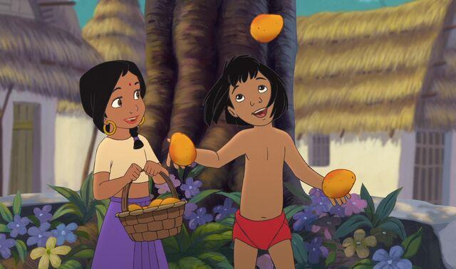 File:Shanti is happy and impressed Mowgli can juggle mangos.jpg
