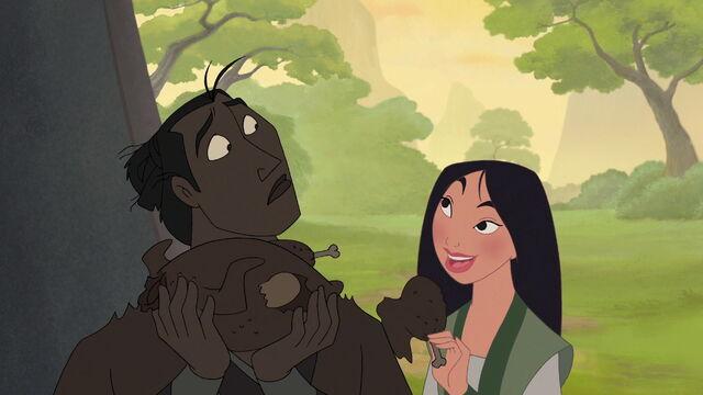 File:Mulan likes the taste of Shang's burnt chicken.jpg