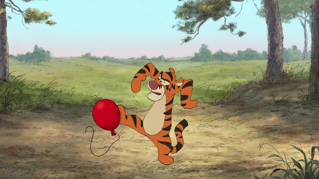 File:Tigger has the red balloon on his foot.jpg