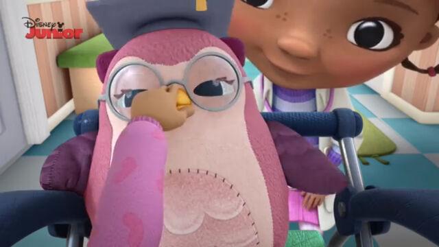 File:Suki grabs professor hootsburgh's beak.jpg