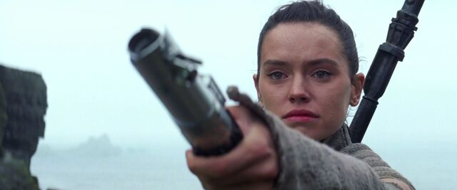 File:Rey Holding Out Lightsaber.jpg