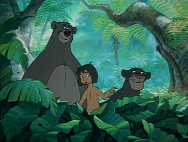 File:Mowgli, Baloo, and Bagheera see the man-village.jpg