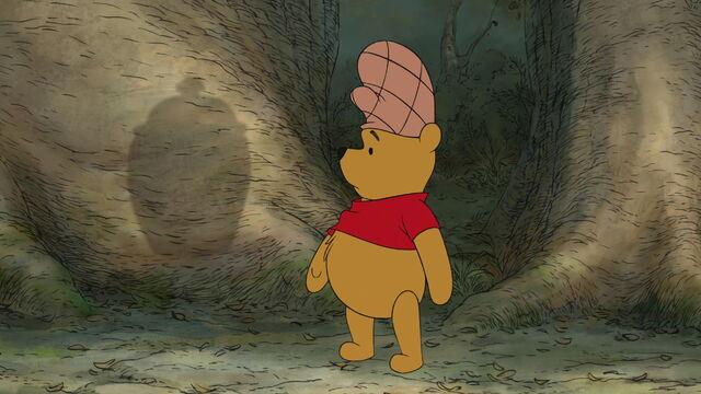 File:Winnie the Pooh found his shadow shaped like a honey pot.jpg