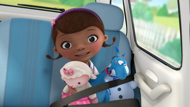 File:Doc and her toys in the car.jpg