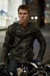Sam Flynn on motorcycle