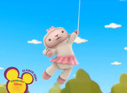 Lambie flying away with a balloon