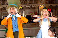 Mad Hatter with Alice in the ragtime coke corner @ Disneyland