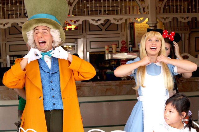 File:Mad Hatter with Alice in the ragtime coke corner @ Disneyland.jpg