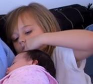 Breanna touching baby niece