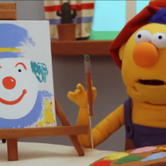 Yellow Guy and his painting of a clown, which gets ruined