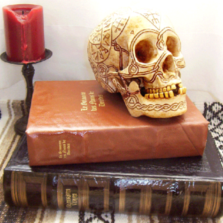 Bob the Skull with runes-on book stack