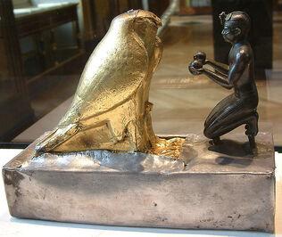 Taharqa kneeling before Hemen