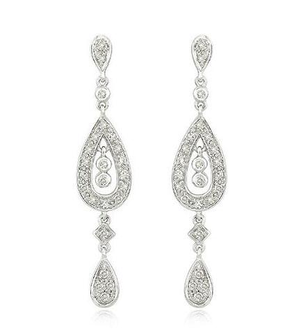 File:White-gold-diamond-earrings.jpg