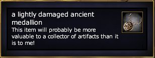 File:A lightly damaged ancient medallion.jpg