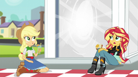 Applejack and Sunset notice the portal activating EG3