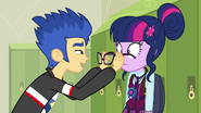 Flash placing Sci-Twi's glasses on her face EG3