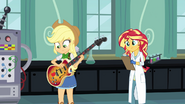 Applejack looks at her bass EG3