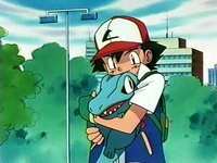 Archivo:EP119 Ash cogiendo a Totodile.png