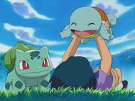 EH14 Gilbert junto a Squirtle