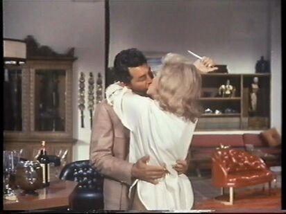 Barbara raises her knife (Nancy Kovack with Dean Martin)
