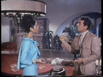 Evil Barbara's corpse on the floor as Tina and Helm chat (Nancy Kovack with Daliah Lavi and Dean Martin) (Large)