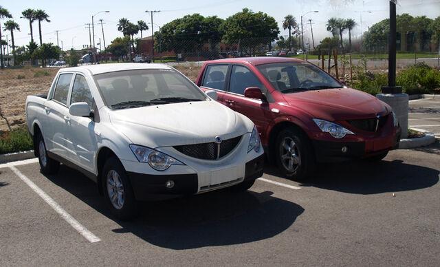 File:Two Phoenix Motorcars in parking lot.jpg